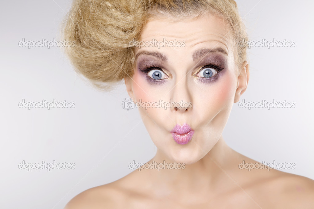 Young pretty woman with beautiful blond hairs and multicolor makeup isolated on white background — Stock Photo #12066839