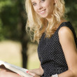 Young woman reading book — Stock Photo #12245694