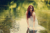 Bride in water — Stock Photo