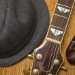 Pipe, hat and guitar on the wood background — Stock Photo