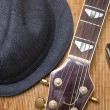 Harmonic, hat and guitar on wood background — Stock Photo #10961781