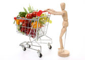 Fruits and vegetables in a shopping cart — Stock Photo