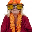 Stock Photo: Elderly blond womwith orange attributes