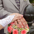 Wedding bouquet and hands with wedding rings — Stock Photo #11872608