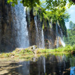 Waterfall reflections in pond (Plitvice Lakes National Park, Cro - Stock Photo