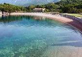 Pink sandy Milocher Beach (Montenegro, Sveti Stefan) — Stock Photo