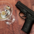 Cocktail and gun — Stock Photo #11033416