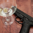 Cocktail and gun — Stock Photo #11233260