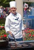 Happy outdoor chef — Stock Photo