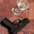 Cocktail and gun — Stock Photo