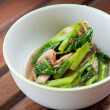 Stir-fried mix colorful vegetables and herb in white round bowl on wood pattern background - Stock Photo
