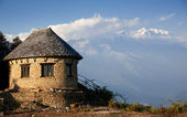 Beautiful evening view of the classic house near Himalayan mountains when see from Sarangkot, Pokhara, Nepal — Stock Photo