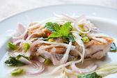 Spicy salad with fried fish and green herb in Thai style — Stock Photo
