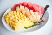 A plate of famous tropical fruits : Pineapple, Cantaloupe and Watermelon — Stock Photo