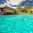 Foto Stock: Over water bungalows with steps into blue lagoon