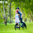 Brother taking his sister on a bike ride — Stock Photo