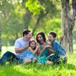 Family laughing during picnic — 图库照片