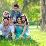 Happy family having fun outdoors in spring park — Stock Photo
