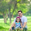 Father and daughter enjoying afternoon in the park - Stock Photo