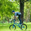 Your boy performing trick on bicycle outdoors — Stock Photo