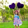 Smilinglittle girl with a heart - Stock Photo