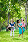 Mother, grandmother and daughters having laugh outdoors — Stock Photo