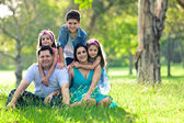 Happy family having fun outdoors in spring park — Stock Photo