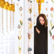Stock Photo: Woman dressed in traditional Arab mosque near columns
