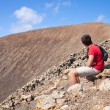 Teenage boy resting, hike up the caldera — Stock Photo