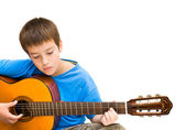 Caucasian boy learning to play acoustic guitar, isolated on white background; horizontal crop — Stock Photo