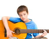 Caucasian boy learning to play acoustic guitar; isolated on white background; horizontal crop — Stock Photo