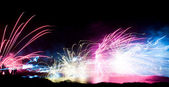 Slhouetted enjoy firework display — Stock Photo