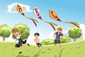 Kids with alphabet kites — Stock Vector