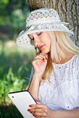 Beautiful girl with a Tablet PC — Stock Photo