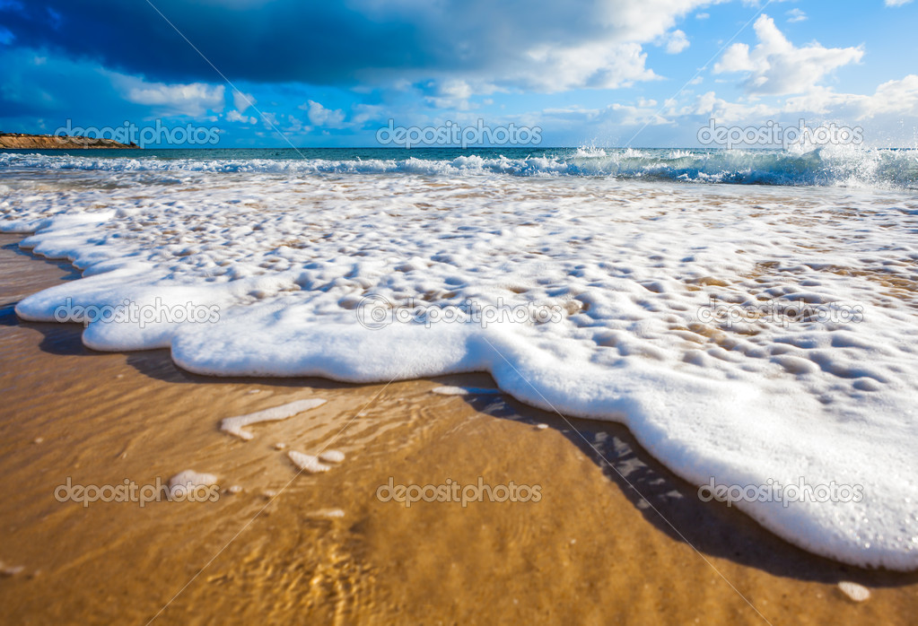 Waves wash over golden sand on Australian beach — Stock Photo #11370407