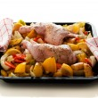 Raw marinated chicken thighs with vegetables on a baking tray — Stock Photo