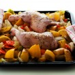 Stock Photo: Raw marinated chicken thighs with vegetables on baking tray