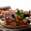Stock Photo: Baked chicken thighs with vegetables on plate