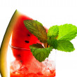 Watermelon smoothie garnished with watermelon slices and mint le — Stock Photo