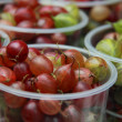 Close up outdoor image of green and red gooseberries with selective focus — Stock Photo