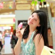Outdoor woman portrait with yummy ice cream — Stock Photo #11783779