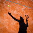 Shadow of a tennis player in action on a tennis court — Foto de Stock