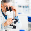 Senior male researcher carrying out scientific research in a lab — Stock Photo #10957235