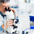 Senior male researcher carrying out scientific research in a lab — Stock Photo #10957266