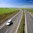 Highway traffic on a lovely, sunny summer day — Stock Photo