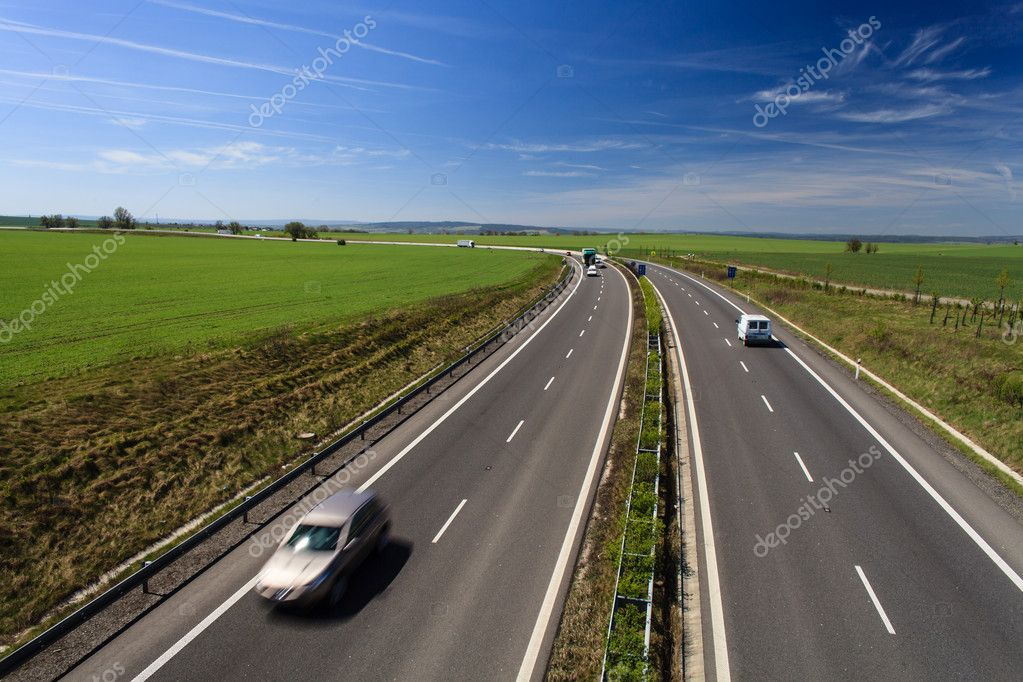 Highway traffic on a lovely, sunny summer day  Stock Photo #10957614