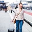 Just arrived: young woman at an airport having just left the air — Stock Photo #11302730