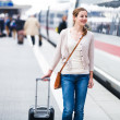 Just arrived: young woman at an airport having just left the air — Stock Photo #11302733