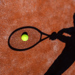 Shadow of a tennis player in action on a tennis court — Stock Photo #11302811