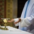 Priest during a wedding ceremony/nuptial mass — Stock Photo